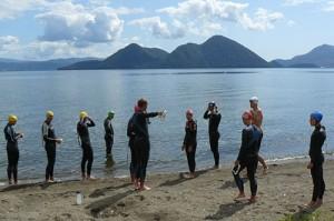 A Hong Kong triathlon team swim training at a recent triathlon camp in Lake Toya